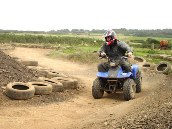 Quad Biking in the mud at Adventures Wales