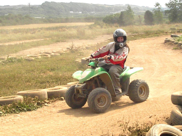 Girl Quad Biking At Adventures Wales