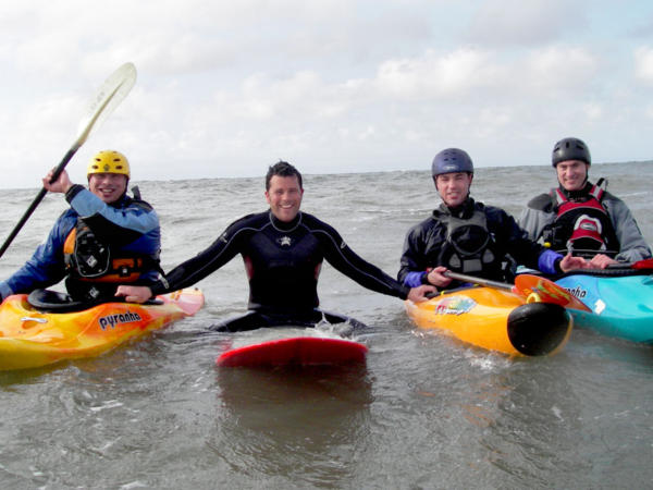 Fun Surfing and Kayaking Team Building Days in South Wales